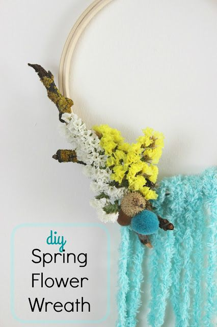 Diy Flower Spring Wreath! A wreath for your home decor with flowers and pom pom and acorns and yarn...so cute! #Spring #diy #craft #tutorial #howto #homedecor #wreath #flower #pompom