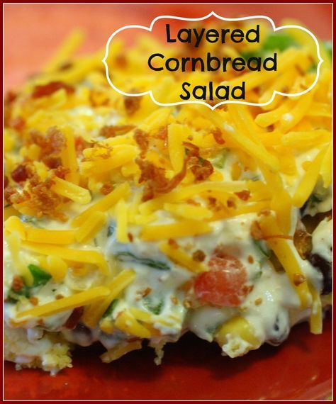 This Layered Cornbread Salad is perfect for a cookout, tailgate, or football party! Easy to prepare and so yummy! A ranch based dressing, with green chilis in the cornbread - layered with tomatoes, green bell peppers, green onions, and of course cheese and bacon!