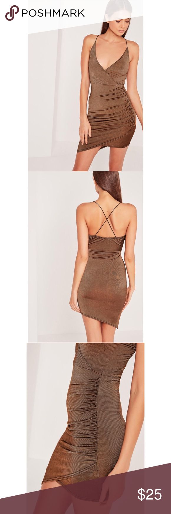 """petite strappy wrap bodycon brown dress This is a petite strappy wrap bodycon brown dress from Missguided. It is a size 4 US or a size 8 UK. It is a petite size so it looks great on girls that are 5'3"""" and under.  This is brand new with tags and I've only worn it to try it on. Unfortunately it doesn't look flattering on me because I don't really have the chest for it but everything else looked great. I'm actually 5'0"""" and 101 pounds and it fitted nicely. Missguided Dresses Asymmetrical"""