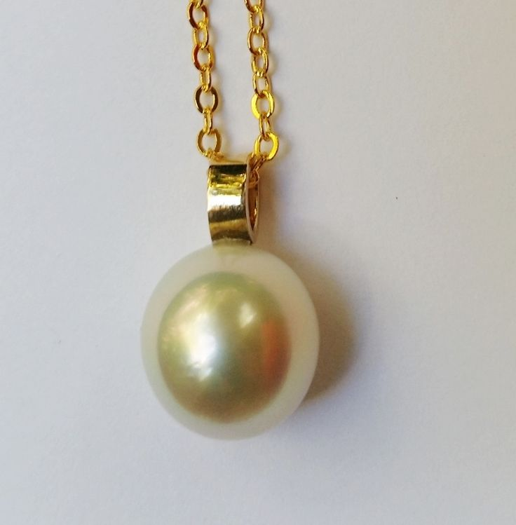 Salt Water & Fire 9ct YG simple pendant featuring approx. 12.5mm Australian South Sea cultured Pearl, near round, white colour with excellent lustre.  (display chain only) $995