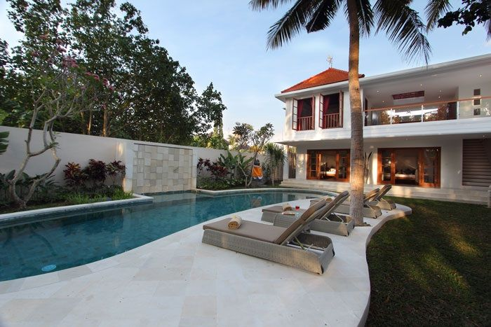The property is a beautiful 3 bedroom private villa combining the modern and Indonesian style, with a peaceful tropical garden surrounded by coconut trees. www.villacocoonbali.com