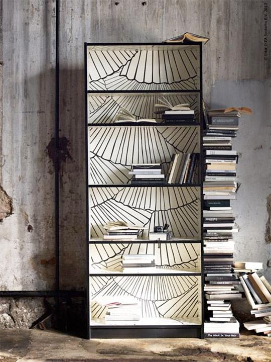 Inspired by open book pages, IKEA is introducing their Billy bookcase in a limited edition run. The black-brown Billy features a printed pattern on the inside (designed by Susanna Löfgren) which jazzes up an otherwise basic bookcase. But you don't have to wait for this in stores — take this idea and make it your own!