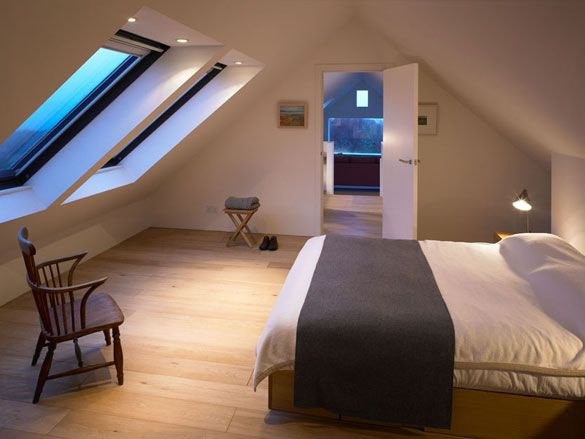Simple and awesome attic bedroom. Love those skylight windows and inset potlights.
