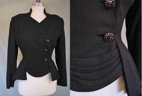 An elegant, form-fitting late 1940s Lilli Ann Jacket in wool crepe with an asymmetrical swag front and black rhinestone buttons.