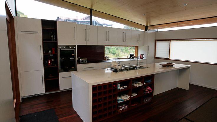 Country Style Kitchen, timber floors, white island bench, window splashback