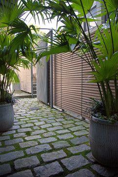 Native moss joints create a soft, porous carpet between antique cobblestones | South End Courtyard | Contemporary Landscape | Boston | Matthew Cunningham Landscape Design LLC