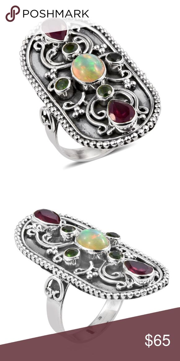 Great Boho Sterling Silver ring with Opal/Ruby Artisan Crafted Ethiopian Welo Opal, Ruby, Russian Diopside Sterling Silver Elongated Engraved Ring (Size 7.0) TGW 3.36 cts.  This is a great Boho  style with 7 beautiful genuine gemstones.  Very detailed workmanship. LC Jewelry Rings