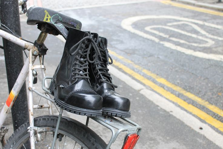 Steel cap boots on a bicycle