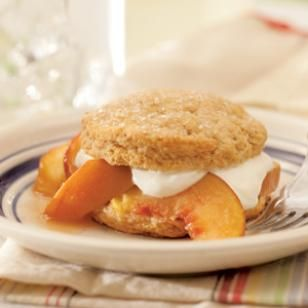 Brown Sugar Peach Shortcakes:  Brown sugar-sweetened shortcakes with fresh, ripe peaches and a lightly sweetened cream topping that's reminiscent of crème fraîche is the perfect ending to a summer meal.