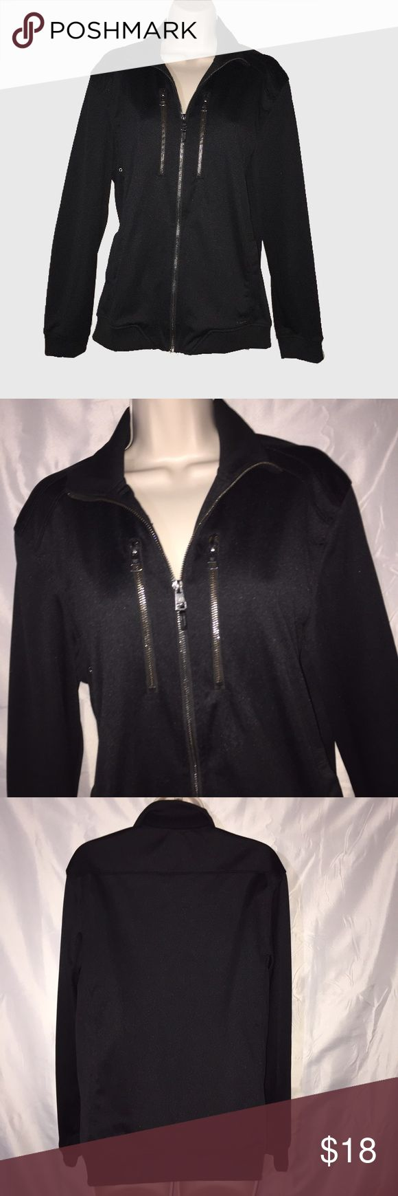 Gender neutral black Calvin Klein zip up Black Calvin Klein gender neutral zip up jacket. Wait. Two front pockets and two regular pockets. More of an active wear item. My flat and unstretched bust measures approximately 19 inches arm weighing approximately 24 inches shoulder approximately 16 1/2 inches total length approximately 26 inches. Body 100% polyester trim 97% polyester 3% spandex Calvin Klein Jackets & Coats