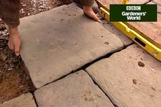 Lay your own garden paving by following Monty Don's DIY advice, including tips on laying slabs on sand and cement - practical video clip from Gardeners' World TV programme.