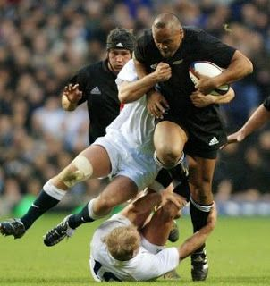 Jonah Lomu and the unfortunate Mike Catt. He he!