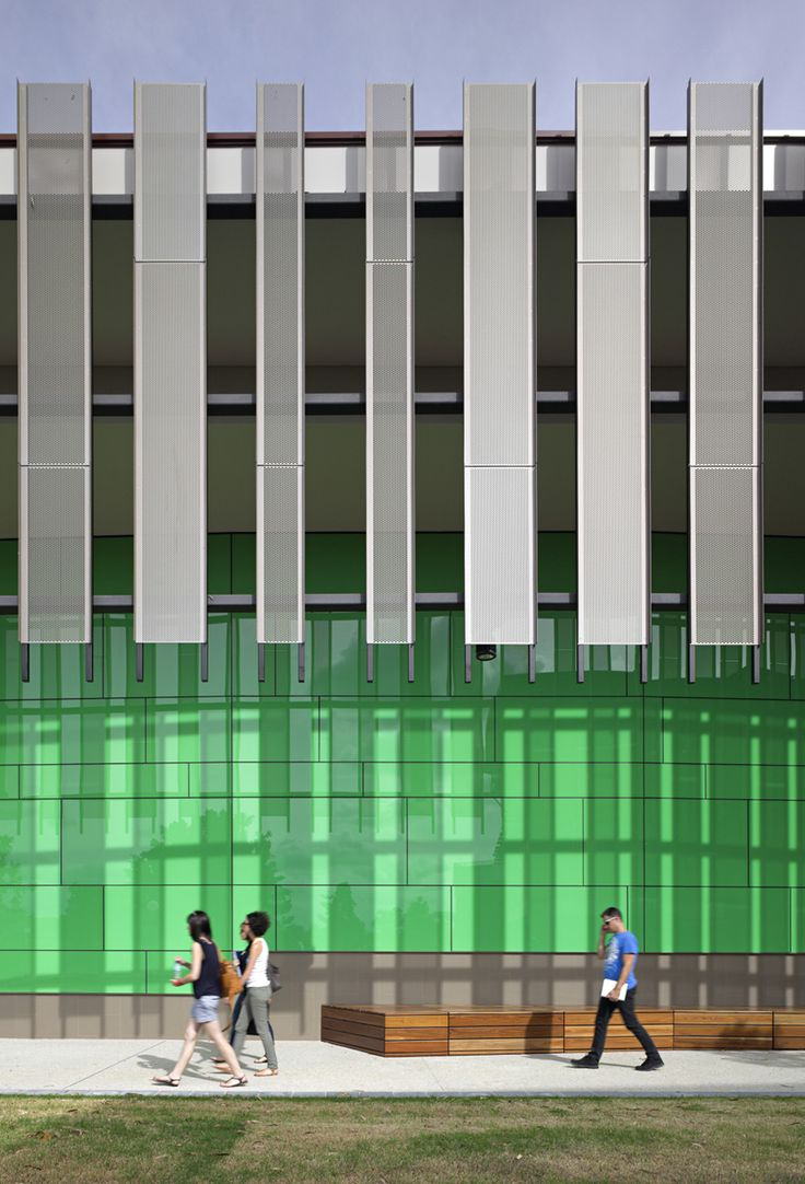 Ipswich Lecture Theatre designed by Wilson Architects in Brisbane Queensland.   Have a look at the way the vertical panels create a cool shadow on the auditorium building   #architecture #design #shadow #students #universityofqueensland