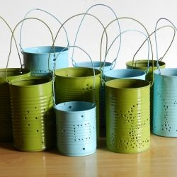 Follow this tutorial to make your own outdoor party lights using recycled tin cans.