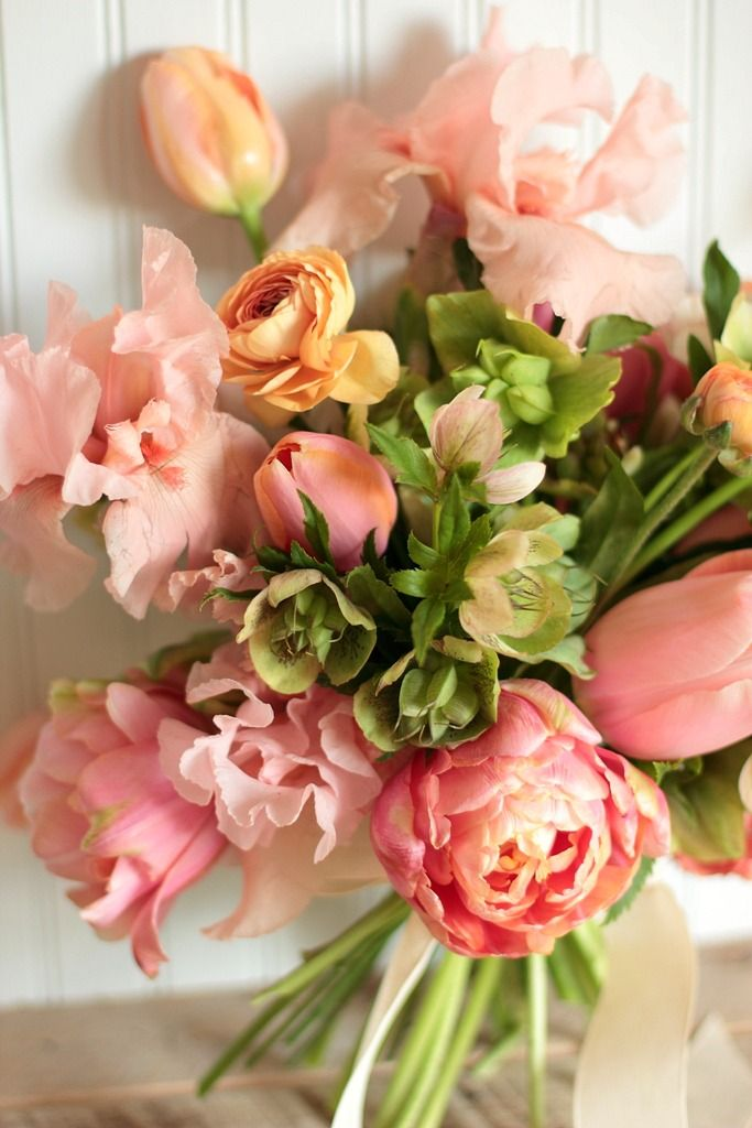 Spring bouquet by Love 'n Fresh Flowers featuring tulips, iris, ranunculus, and hellebores..