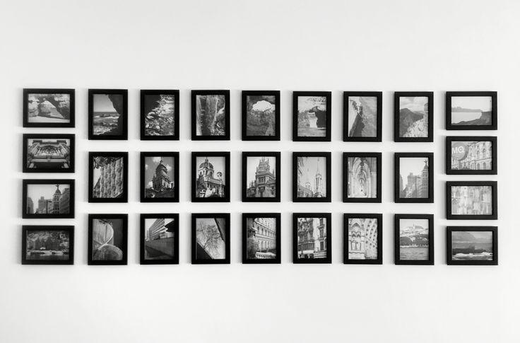 Photo-wall, using Ikea's cheap Fiskbo photo frames.