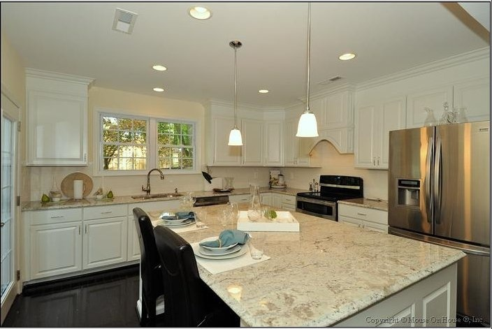 I love the white cabinets with the light colored granite.  So refreshing!