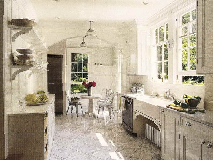 I do really like this, but we don't have the natural light which I think you really need to liven up the white on white on white (also might require us to identify a diff style flooring, white with gray vs travertine look)