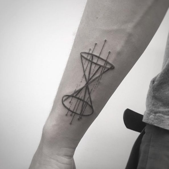 Hourglass tattoo on wrist by Balazs Bercsenyi
