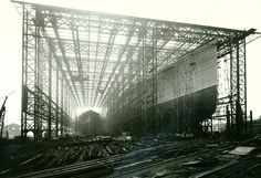 """Mauretania Construction Photograph of the nearly completed vessel 'Mauretania' in September 1906. The West shed used to build the """"Mauretania"""" was 728 ft long x 95 ft wide x 130 ft high complete with a glass roof. It survived until 1959. RMS MAURETANIA was one of the most famous ships ever built on Tyneside. Reference: TWAS: 2931.NT.13"""