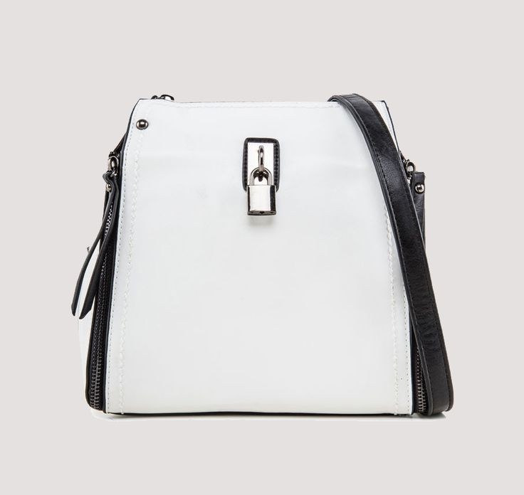Dual Way Backpack With Lock Detail by Something Borrowed. Multifunction bag that you can use in two way, complete your edgy look with this edgy bag. With one main compartment, inner pocket and gadget sleeve, handle drop 30 cm, shoulder strap 52 cm. With white white color and black, this bag look so clean and look so minimalist.    http://www.zocko.com/z/JHBh1
