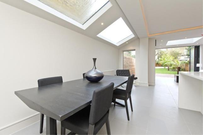 nice side return white kitchen, pale grey large floor tiles