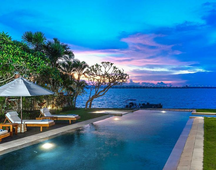 Located in a quiet lagoon of the popular resort area Tanjung Benoa, this villa welcomes its guests with the unforgettable ocean views. That, and a 20-meter-long swimming pool with Jacuzzi right on the ocean front, cozy pool-side gazebo and the statue of a meditating Buddha overlooking the pool and symbolizing balance and harmony.  http://bit.ly/2raWMk2  . #Bali #villas #sunset #travel #Instagram #balivillas #geriabali #ootd #balibible #dinner #luxwt #Facebook #luxuryvilla #trip #hgtv