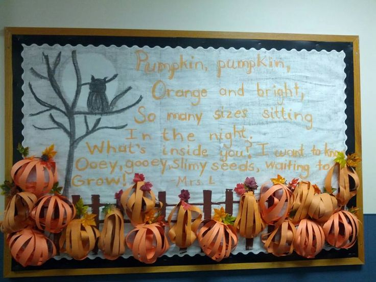October Bulletin Board with 3D construction paper pumpkins, pumpkin poem, and owl silhouette.