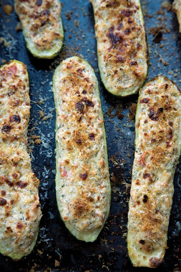 In this dish, zucchini are stuffed with the twin stars of Calabrian cheese making: pecorino and ricotta. Flecked with tomato and mint, they are equally good eaten hot or at room temperature.