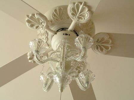 Ceiling fan with chandelier, yes please! I'd love if I could find the chandeleir part as a light kit at my local hardware store.