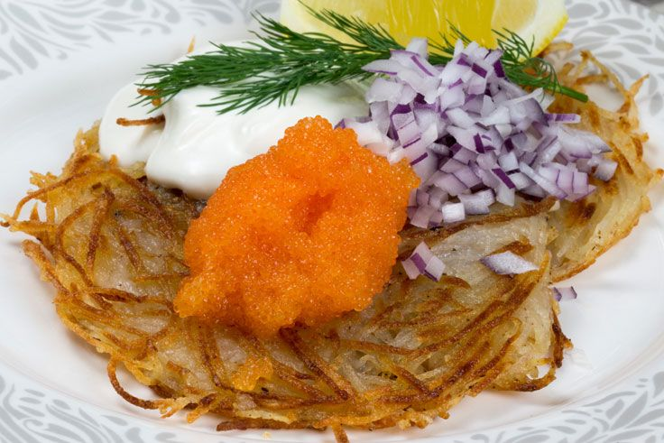 Potato cakes with roe Rårakor med löjrom  Swedes love roe, sometimes called caviar, and this is a delicious simple way of serving it. Don't be scared of frying the potato cakes because they are really easy to cook and don't need much attention.