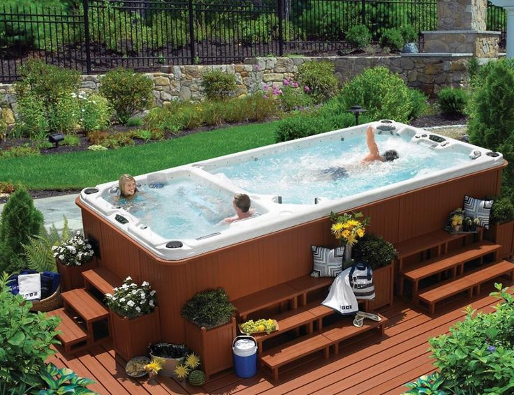 The Olympian offers both a heated swim zone and an attached spa zone. #calspas #swimspa