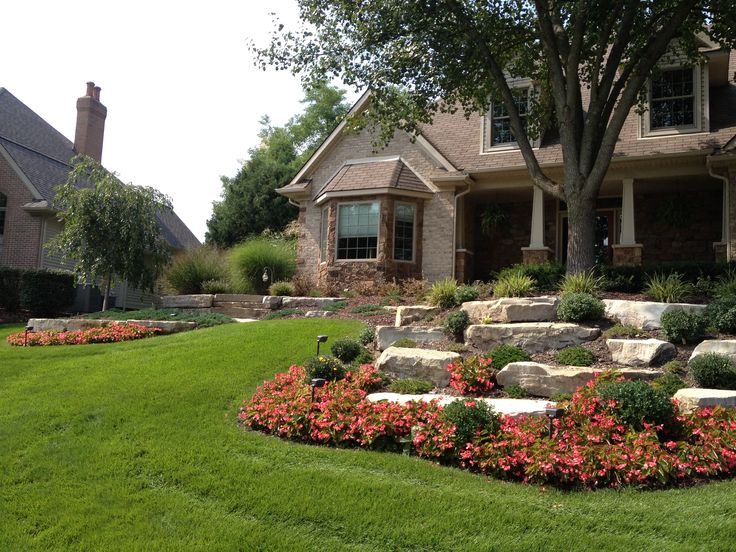 Limestone outcroppings retaining hill and adding beauty for Landscaping a hill with rocks