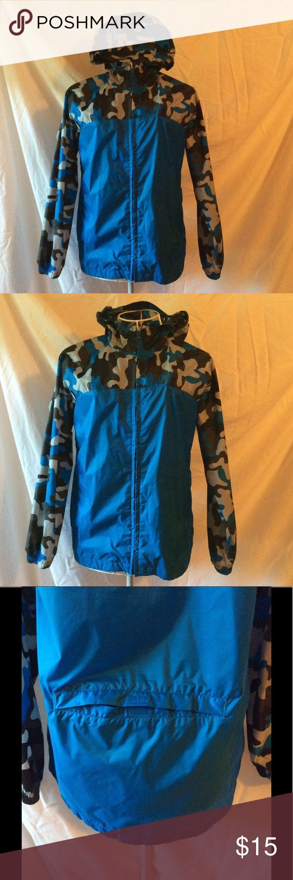 Land's End Kids rain jacket Land's End Kids rain jacket; 100% nylon; blue with camo sleeves and hood; folds into a pouch on the back; only worn once or twice; Size M 10/12 Land's End Kids Jackets & Coats Raincoats