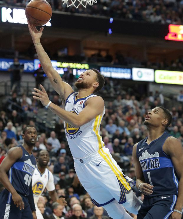 Golden State Warriors guard Stephen Curry (30) drives past Dallas Mavericks guard Dennis Smith Jr. (1) during the first half of an NBA basketball game in Dallas, Wednesday, Jan. 3, 2018. (AP Photo/LM Otero)
