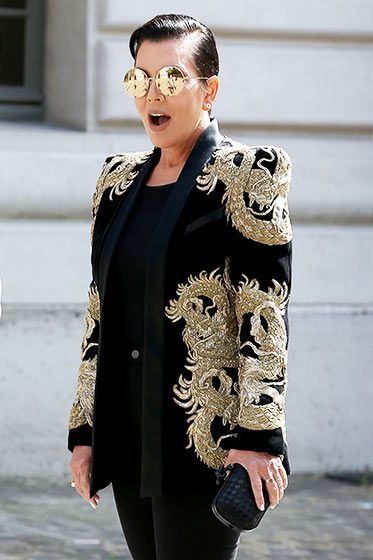 Kris Jenner stole Justin Bieber's Met Gala look in this embroidered black and gold jacket during Paris Fashion Week.