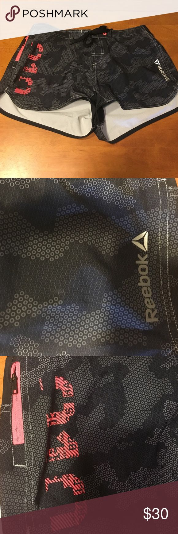 Reebok CrossFit shorts Rebook CrossFit shorts with front tie and orange trim. Never worn. Reebok Shorts