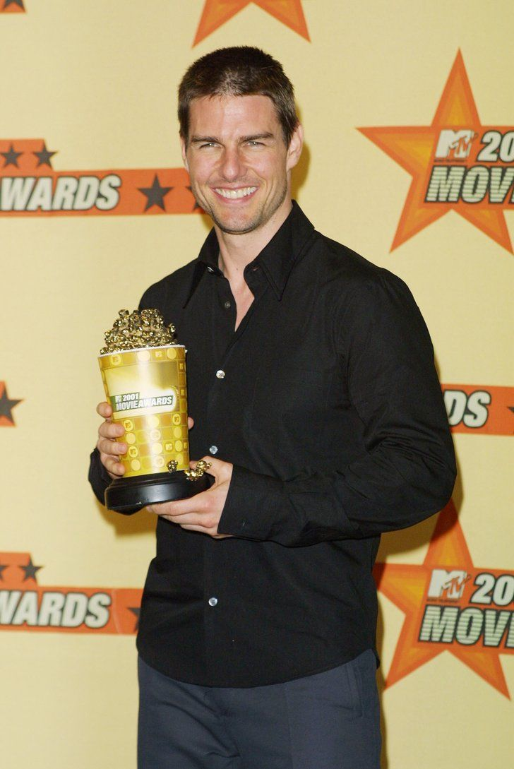 Tom Cruise showed off his award winning smile accept his golden | These Hot Tom Cruise Pictures Will Convince You Age Is Just a Number | POPSUGAR Celebrity Photo 3
