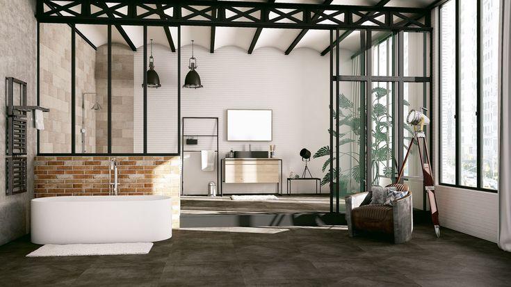 L'alliance métal-bois du meuble et les matières brutes, comme le carrelage sol imitation béton usé ou la robinetterie finition inox brossé, sont dominants dans cette salle de bain. La paroi de douche verrière signe véritablement le style.