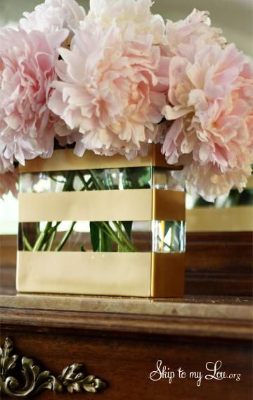 Got a plain glass vase, a roll of painter's tape, and a can of gold spray paint? You're all set with the components for a project like blogger Cindy Hopper's striped vase. Simply tape off a pattern you'd like on the clean, outer side of the glass and spray away! Seal your work with a clear acrylic spray for the best results, and keep your revamped vase out of the dishwasher.