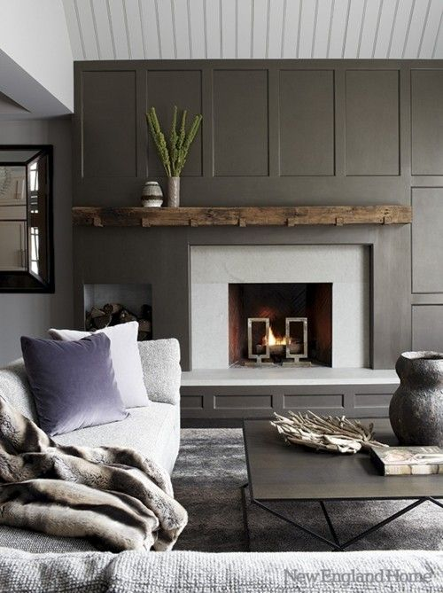 Dark gray Modern Fireplace wall, with rustic wood mantel.