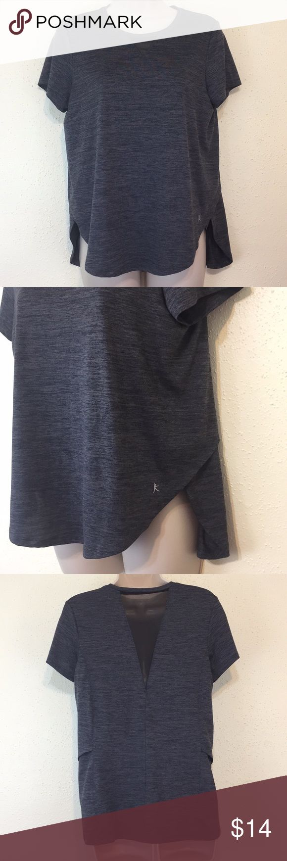 Danskin Now Gray Cutout Athletic Shirt Loose fitting and lightweight Heathered Gray Athletic Top. Slots on sides. Mesh triangle cutout on back. Gently worn. Danskin Now Tops Tees - Short Sleeve