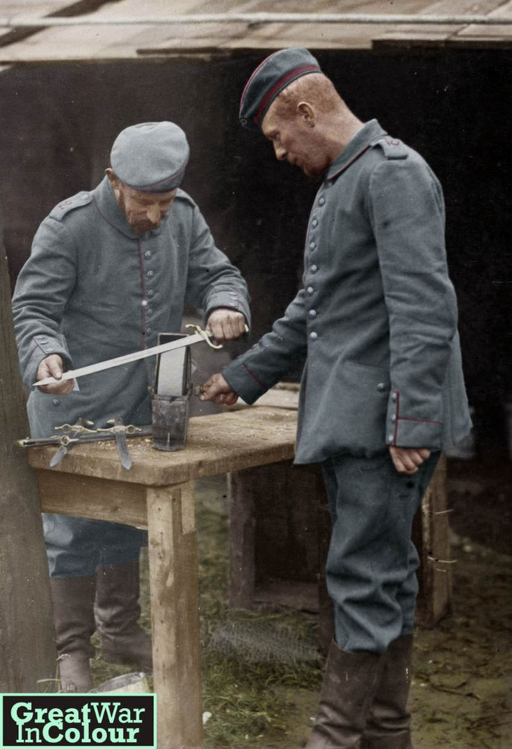 Two German soldiers sharpen swords, circa 1915. As seen on the cover of the German newspaper,  Münchner Illustrierte.