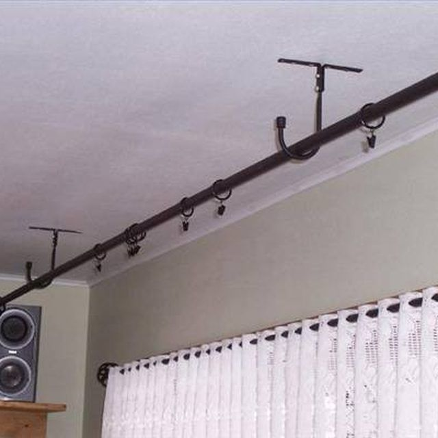 How to Hang a Curtain Rail Hanging From the Ceiling