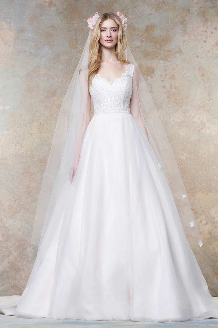 The beautiful 11456 wedding dress from Ellis Bridals combines subtle yet timeless nods to Rapunzel's A-line cap sleeve dress in Tangled