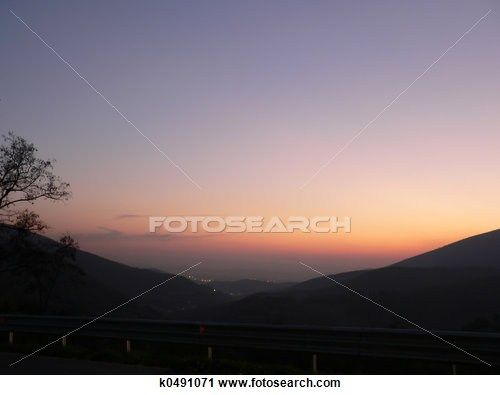 Silhouette landscape of a valley in tuscany