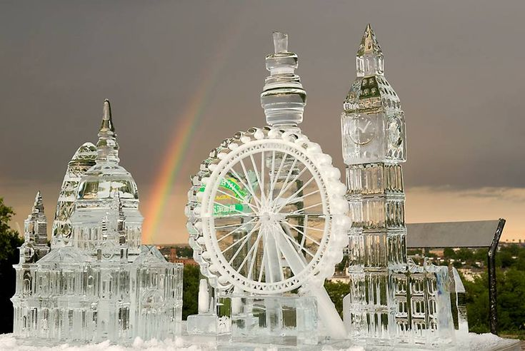 ice carving - beautiful so shimmery.notice the rainbow behind.gorgeous!