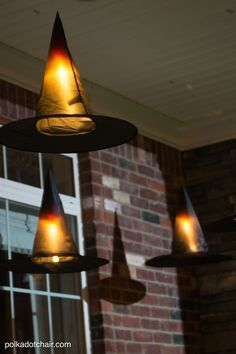 Clever decorating idea for a porch for Halloween, floating Witch's hat…