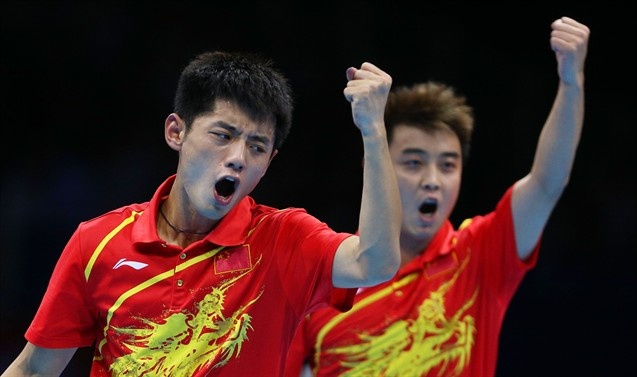 Zhang Jike (L) and Wang Hao (R) of China celebrate as they compete against Seungmin Ryu and Sang Eun Oh of Korea.