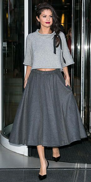 Selena Gomez in a gray midi circle skirt and cropped ...